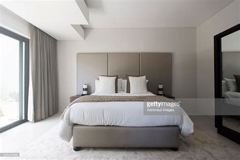modern white bedroom modern white and beige bedroom with double bed stock photo