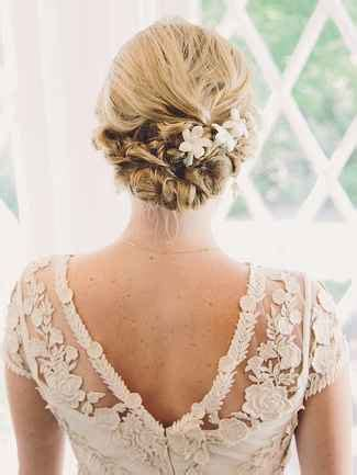 Bridal Hairstyles Low Bun With Flowers by 17 Wedding Hairstyles For Hair With Flowers