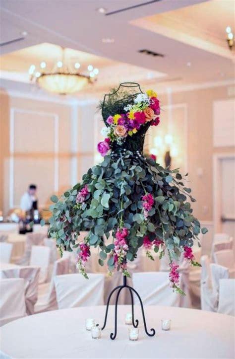 floral arrangement on wire framed mannequin mannequin