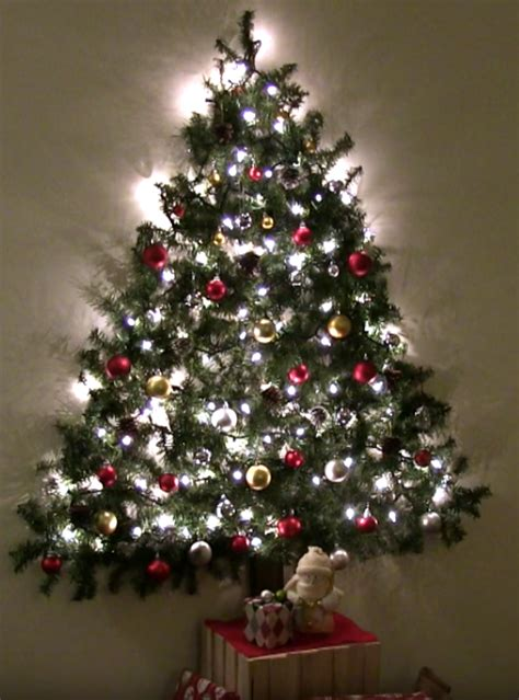 how to make a wall christmas tree wall mounted tree saves space by attaching garland lights