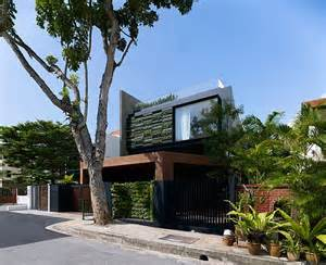 Singapore Vertical Garden Contemporary Home In Singapore With Sloping Rooftops And