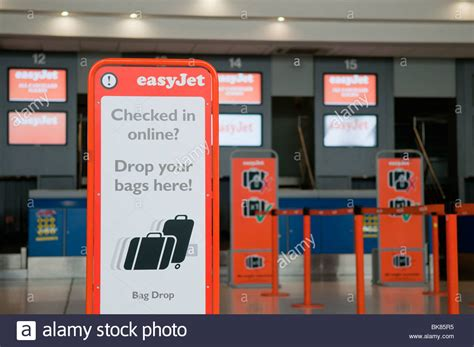 easyjet check inn easyjet check in desks with sign for bag drop stock photo