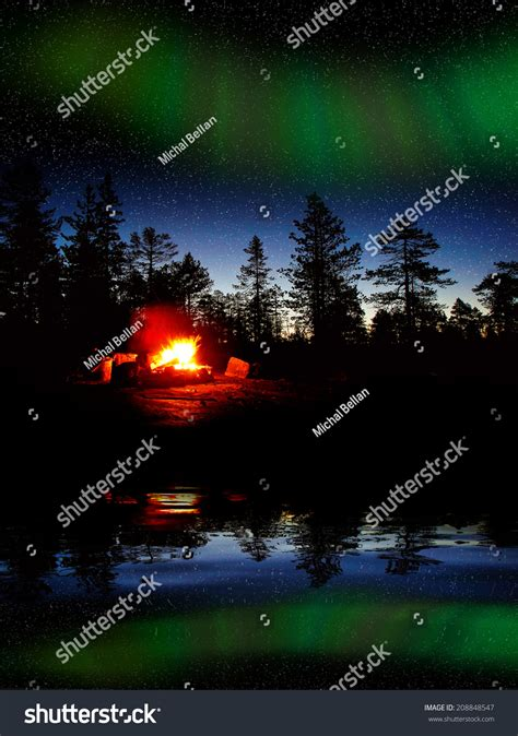 the light of northern fires burning forest northern lights stock photo