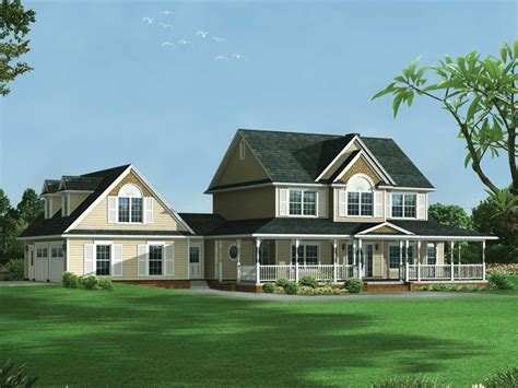 house plans with 2 separate attached garages farmhouse style two story house has garage with dormers on