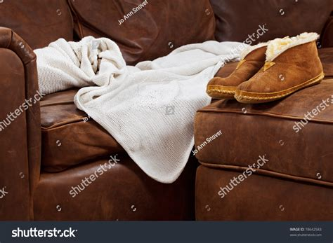 throw blanket for leather couch slippers and throw blanket on a soft leather sofa stock