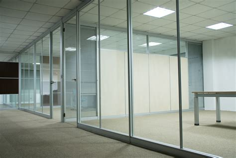 kayak startup tech office glazed interiors in reflective orange white and glass interior office glass wall