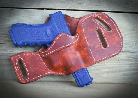 Handmade Leather Pistol Holsters - buy a handmade leather gun holster made to order from