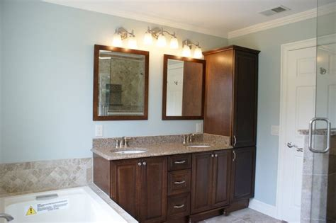 vanity and linen tower traditional bathroom new york
