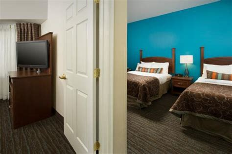 2 bedroom suites in baltimore md lounging by the pool picture of staybridge suites