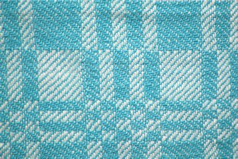 pattern woven into fabric teal and white woven fabric texture with squares pattern