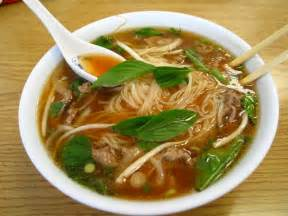 pho and roasted duck head intact collab kitchen