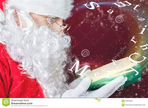 blowing dandelions letters for santa merry christmas with santa claus reading fairy tale stock