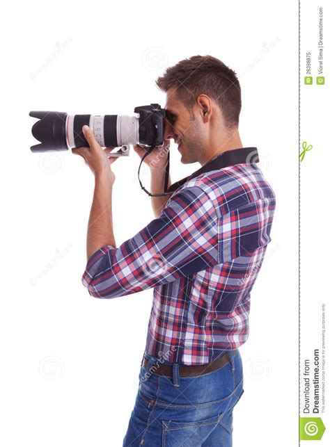 Taking A by Side View Of A Photographer Taking A Photo Stock