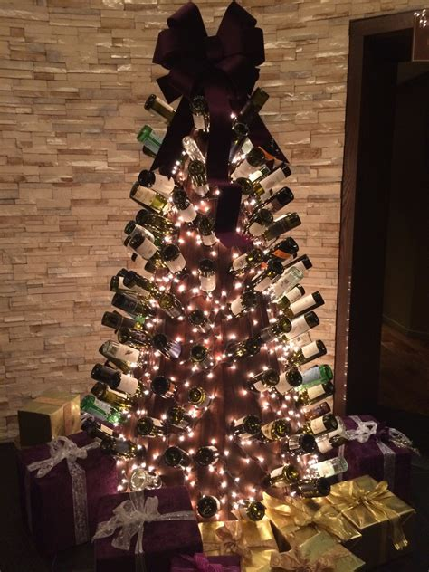 this christmas tree is made out of empty wine bottles