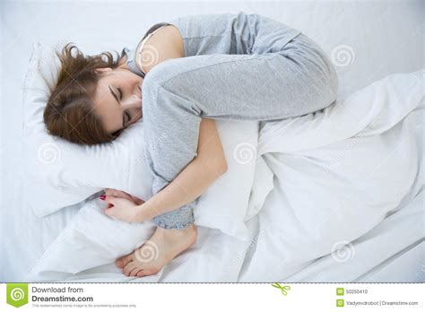 how to get her in bed woman sleeping in her bed in pajamas stock photo image
