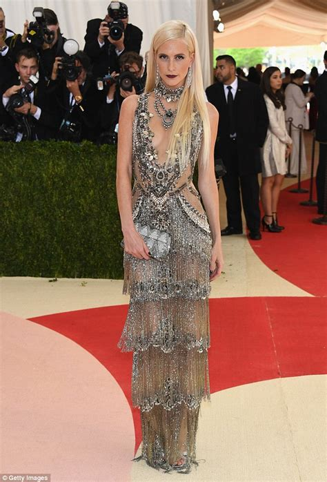 poppy delevingne wears  plunging tiered silver gown