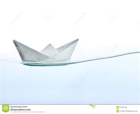 Origami Boats And Ships - origami boat on water royalty free stock image image