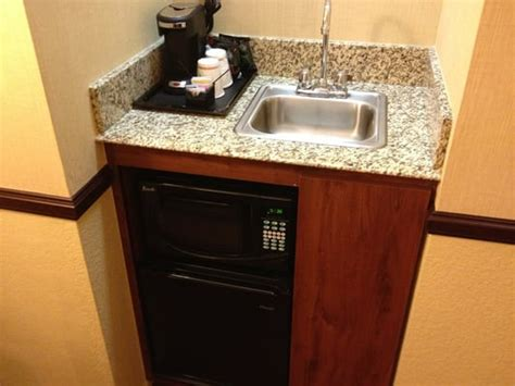Mini Bar Sink Typical Coffe Maker Microwave And Small Reefer Bar