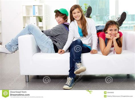 friends on couch friends on sofa stock photography image 33940662