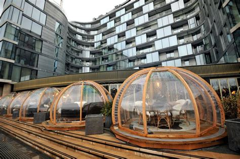 dine in a heated igloo on the banks of london s river london restaurant coppa club and its festive dining igloos