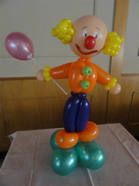varias imagenes en una figura latex wow globofexia y figuras con globos con super animaciones