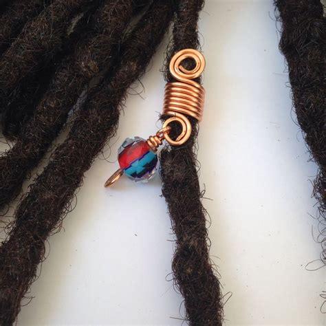 pictures of twisting braids made with dread attachment on bella naija dreadlock braid twist hair bead dread locs jewelry store