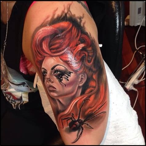 spider face tattoo and black spider on arm sleeve