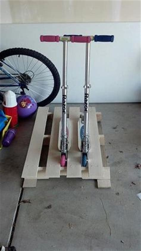 Razor Scooter Storage Rack by 1000 Ideas About Scooter Storage On Garage