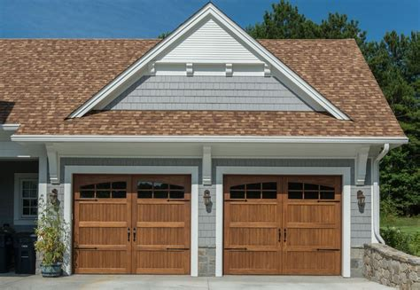 white house brown roof garage traditional with glass
