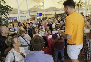 tourists arrive home on flights from sharm