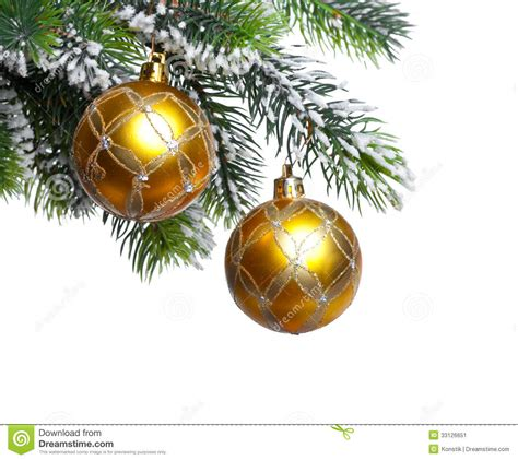 new year yellow tree two yellow new year s balls and snow covered branches of a