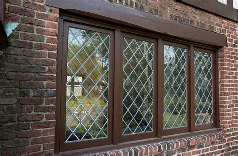 Tudor Style Windows Decorating Tudor Style Windows With Brown Windows Frame And Brick Wall Home Interior Exterior