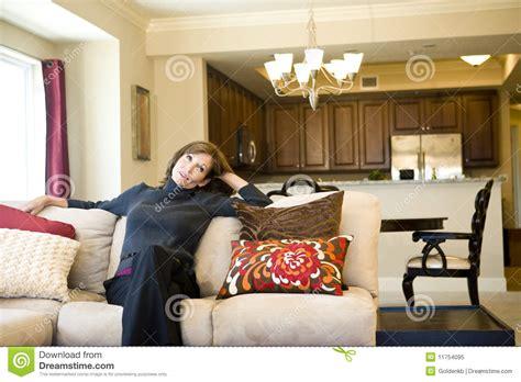 mature woman relaxing  living room sofa stock image