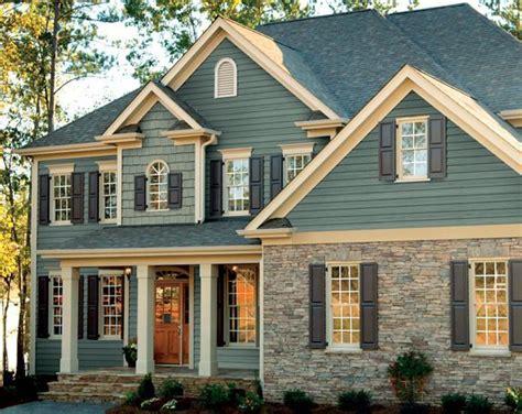 craftsman style home  beautiful wood garage doors