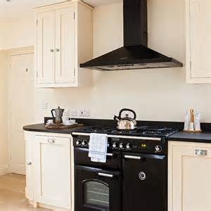 Ao Kitchen Appliances - neutral kitchen with black range cooker decorating ideal home