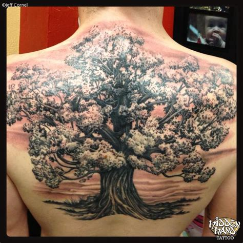 black and grey tree hidden hand tattoo seattle wa