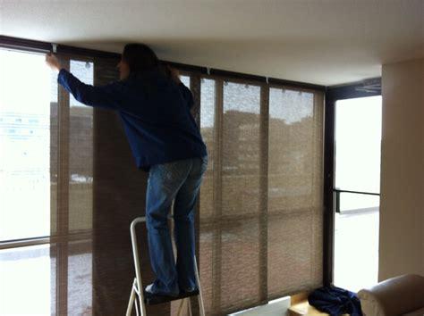 sliding solar screen panels for a 21 ft floor ceiling