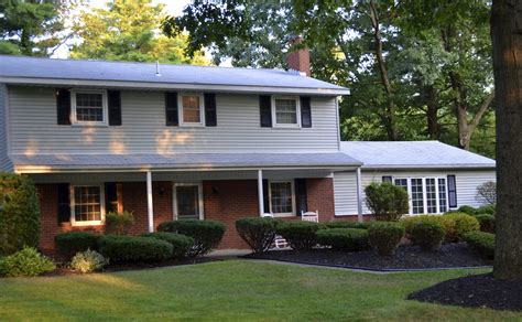 find a house black roof cream siding red brick google search