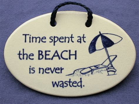 fun beach  mountaine meadows pottery wall plaques  sayings