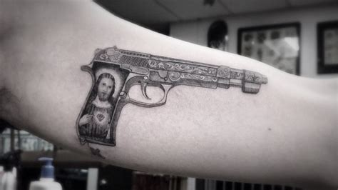 jesus gun tattoo 20 gun tattoo pictures images and design ideas
