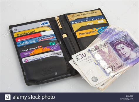 Buy Visa Gift Card With Amex - black wallet with assortment of credit cards visa and american stock photo royalty