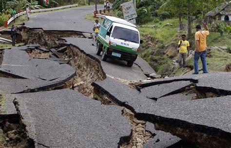 Earthquake Recent | filipinos grieve as earthquake death toll rises photos