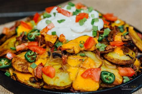 nacho supreme potato nacho supreme plate of yum