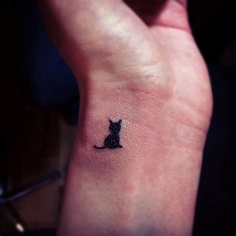 tiny cat tattoo small cat silhouette on side wrist