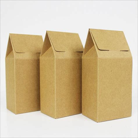 two cardboard boxes and a suitcase for the other victims of alzheimer s books kraft paper box paper packing box house shape kraft paper