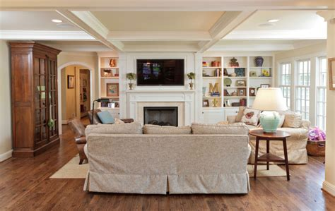 living room with fireplace and tv hanging your tv over the fireplace yea or nay driven