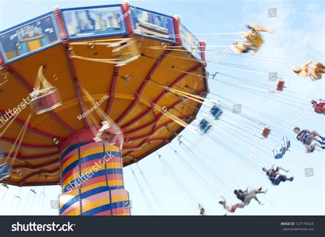 People Swing Past Motion Blur Shot Stock Photo 127179524