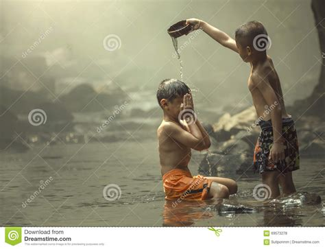 two boys on the creek stock photo image 69573278