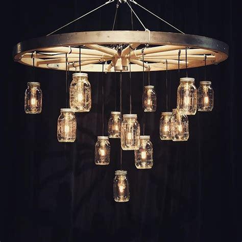 wagon wheel light with jars best 25 wagon wheel chandelier ideas on