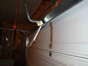 garage door opener ripped from door building